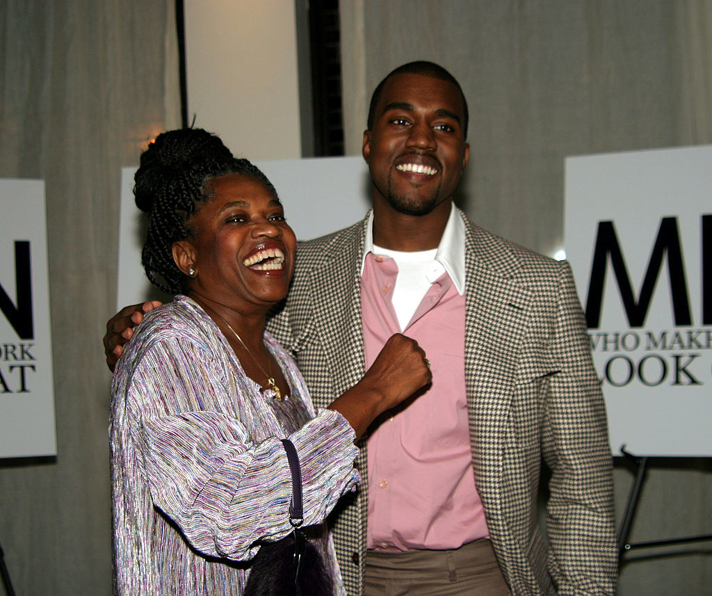 Kanye with his arm over his mother's shoulder