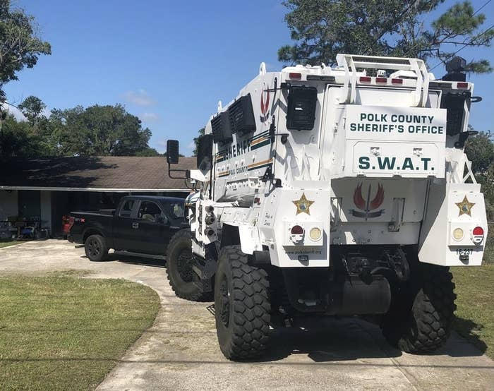 """Armored vehicle with """"Polk County Sheriff's Office SWAT"""" on the back parked in a driveway"""