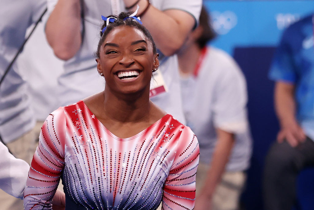 Simone smiling widely