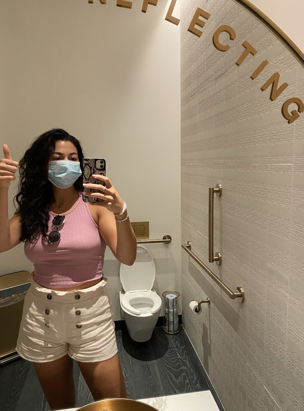 A mirror selfie of the author at the acupuncture center