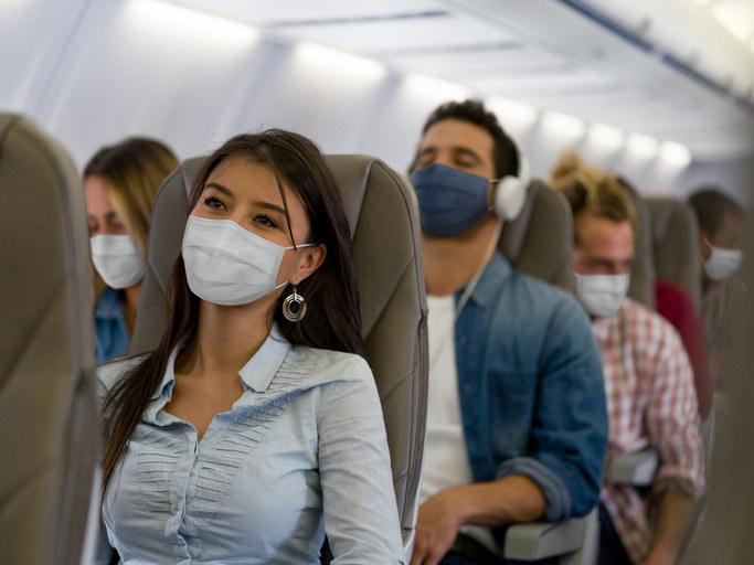 People wearing face masks on a flight