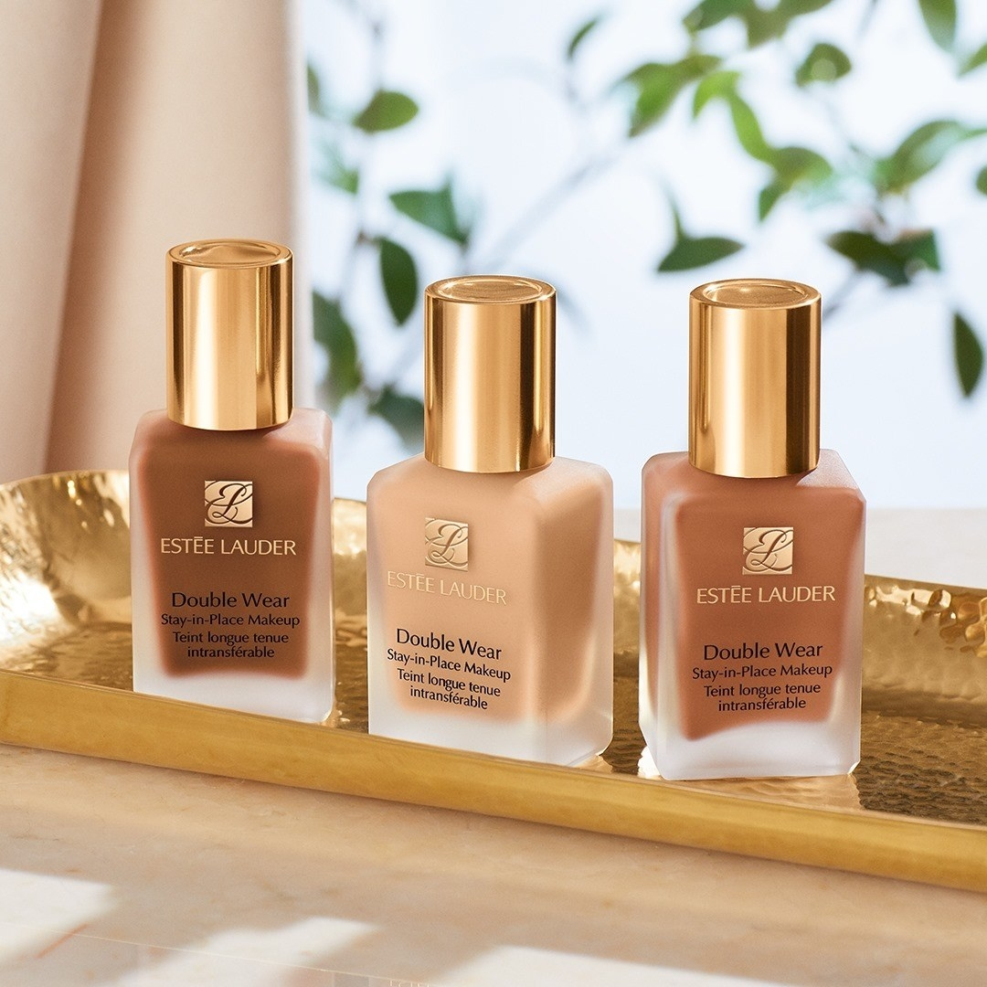 Three bottles of foundation on a tray