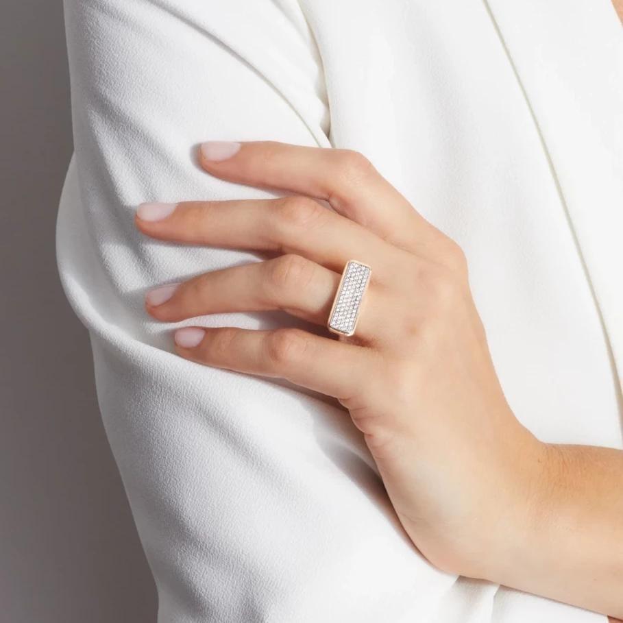 diamond bar ring on a model's ring finger