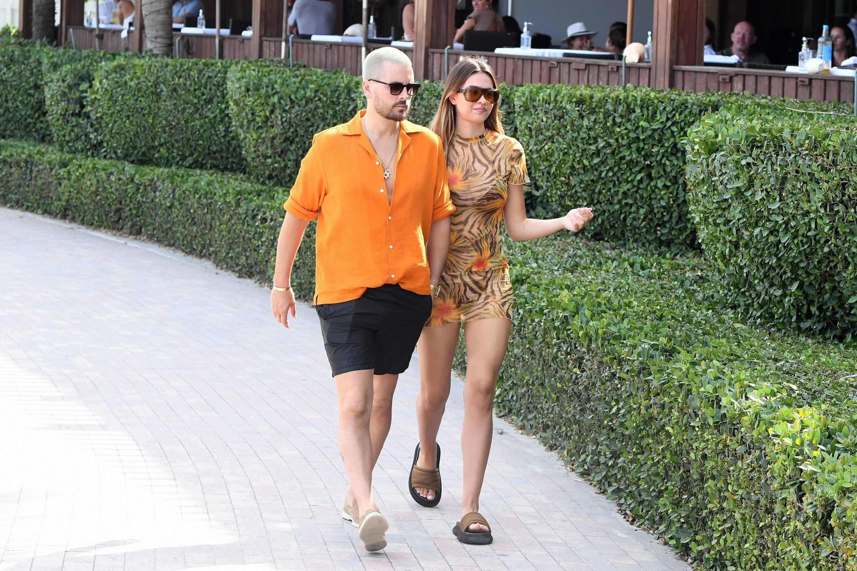 Scott and Amelia walking together