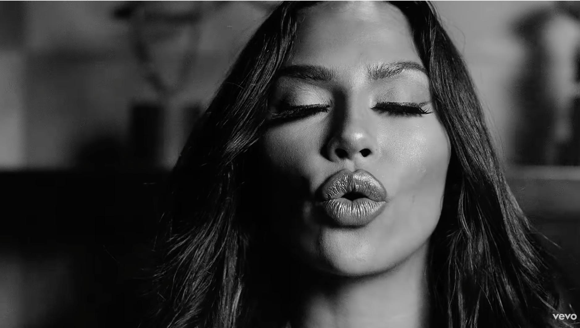 Woman pursing her lips