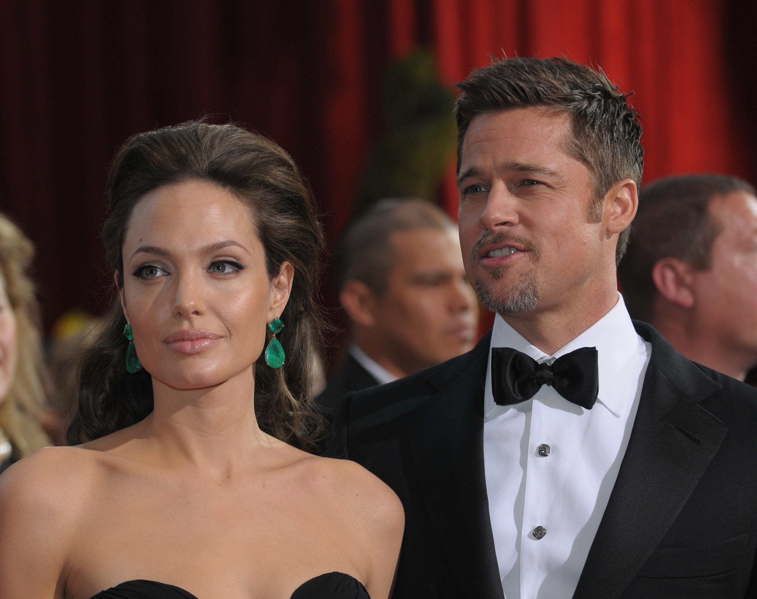 Angelina in a strapless outfit and Brad in a bow tie