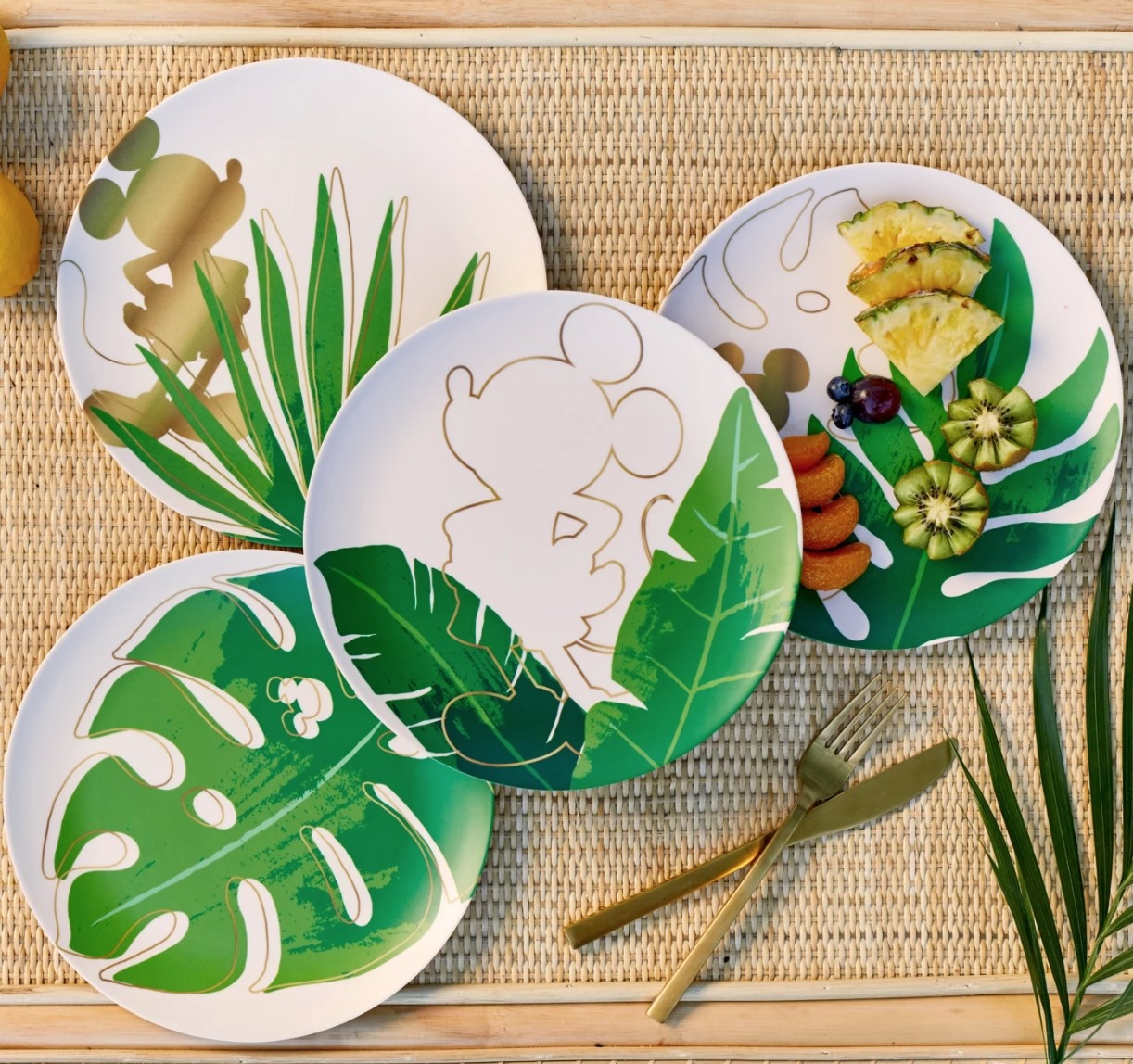 Set of four melamine plates with Mickey icons and tropical leaf print