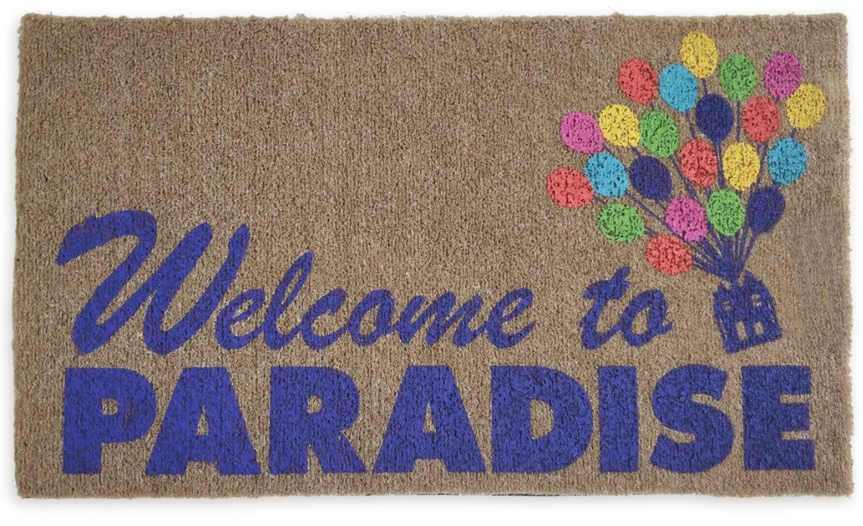 """A doormat with the words """"welcome to paradise"""" and a house with balloons from the movie Up"""