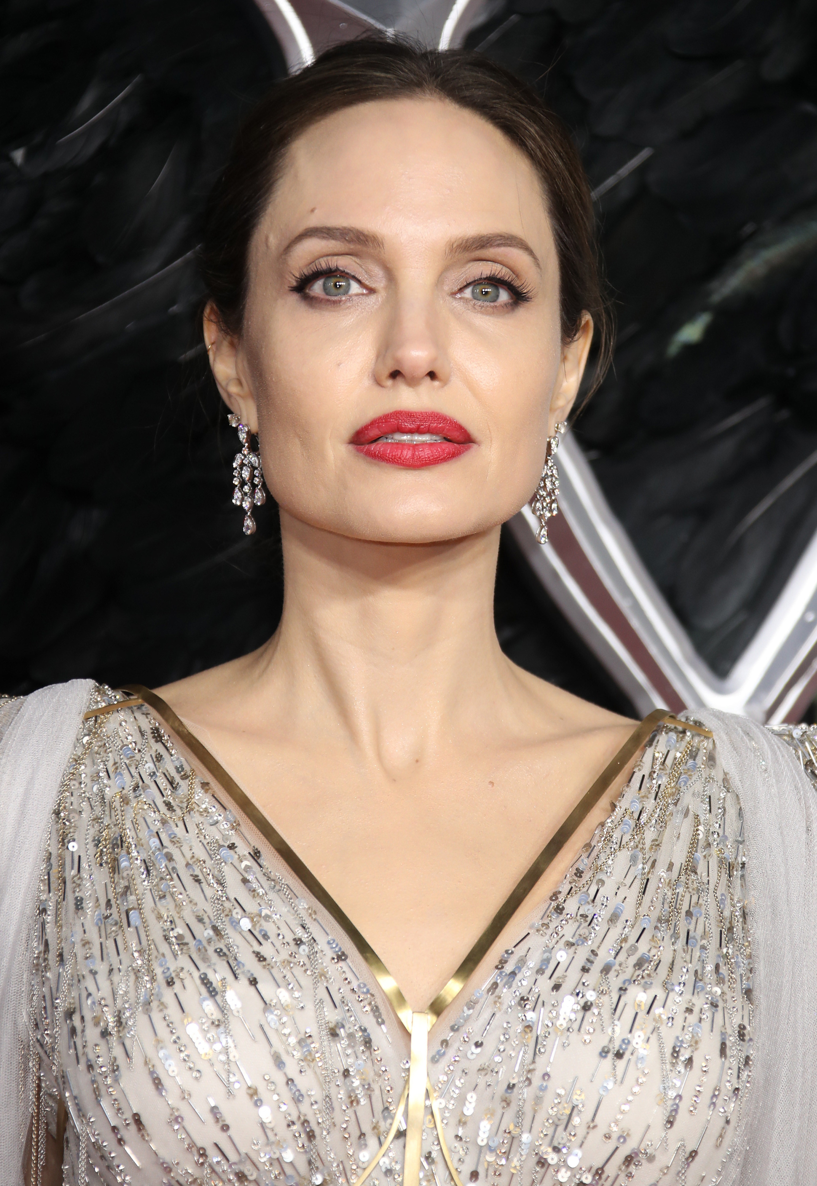Close-up of Angelina on the red carpet with dangly earrings