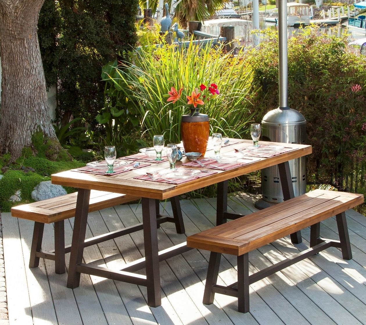 a wooden table and matching benches
