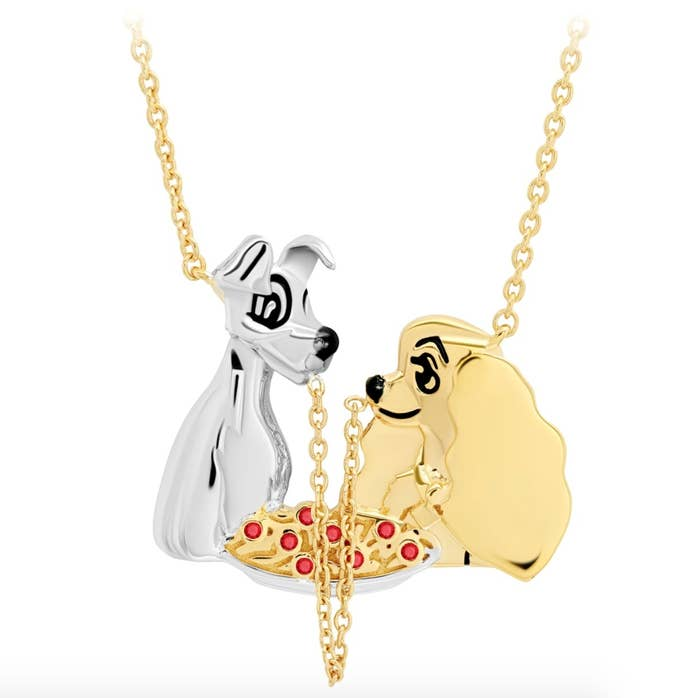 A necklace featuring Lady and the Tramp sharing a pice of spaghetti, which is a necklace chain