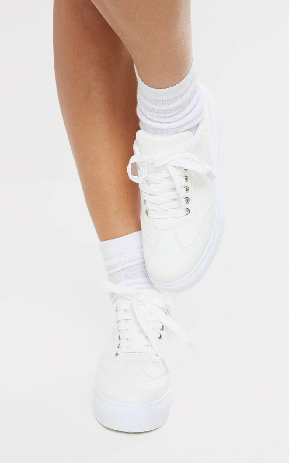 model's legs wearing scrunched socks and the platform sneakers