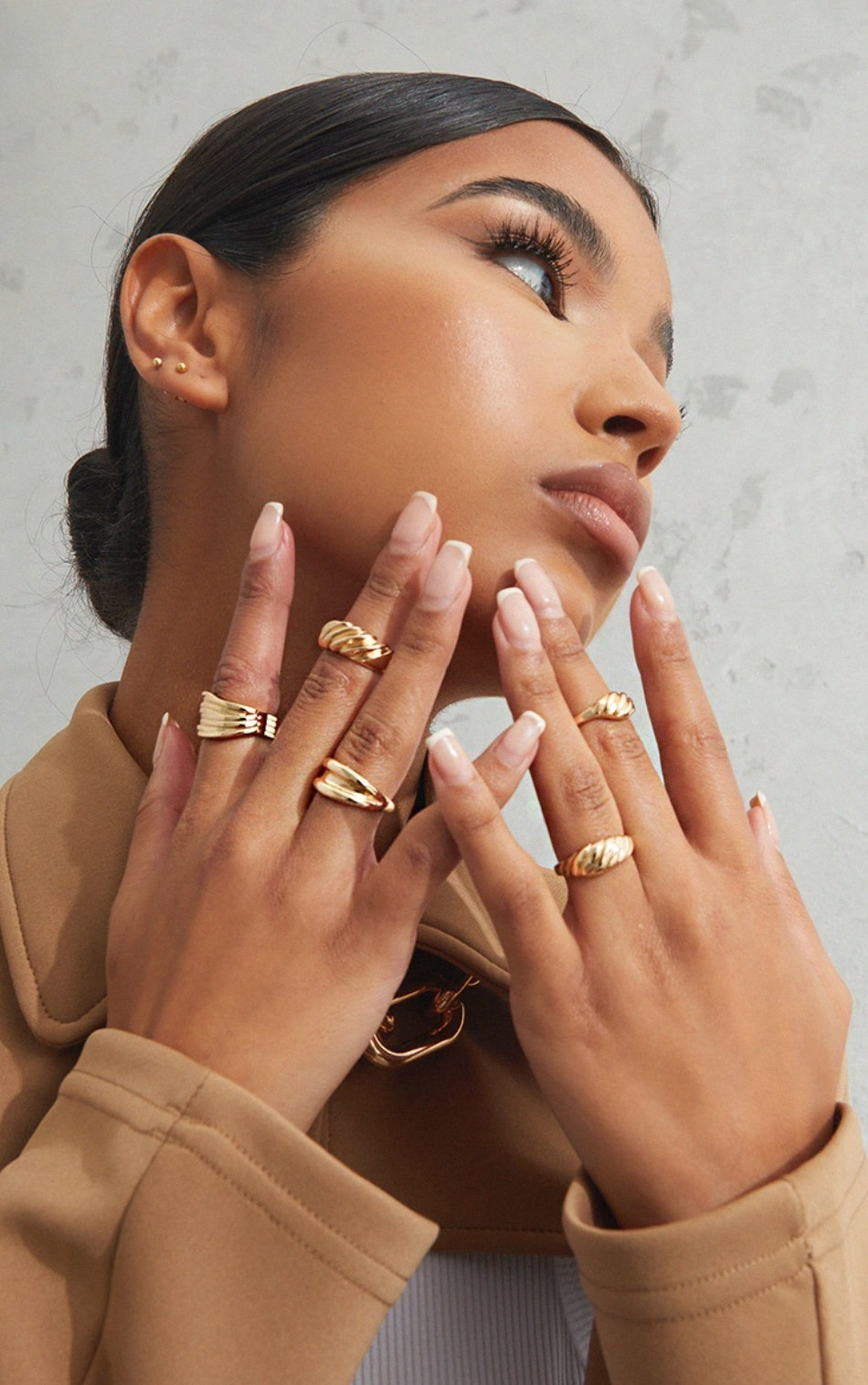 model holding hands up to the face wearing the five chunky rings