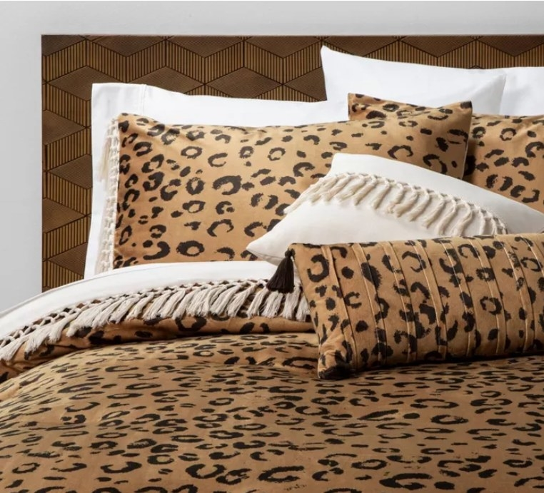 A leopard comforter on a bed