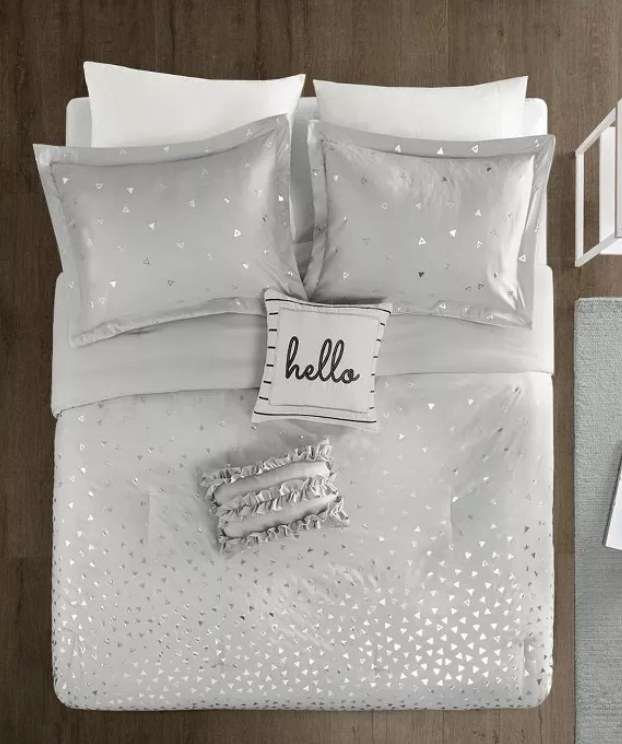 """Gray metallic printed bed spread with a a pillow that says """"Hello!"""""""