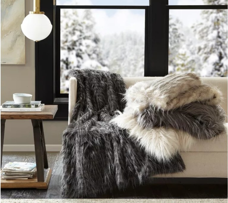 A few furry blankets in white and gray colors