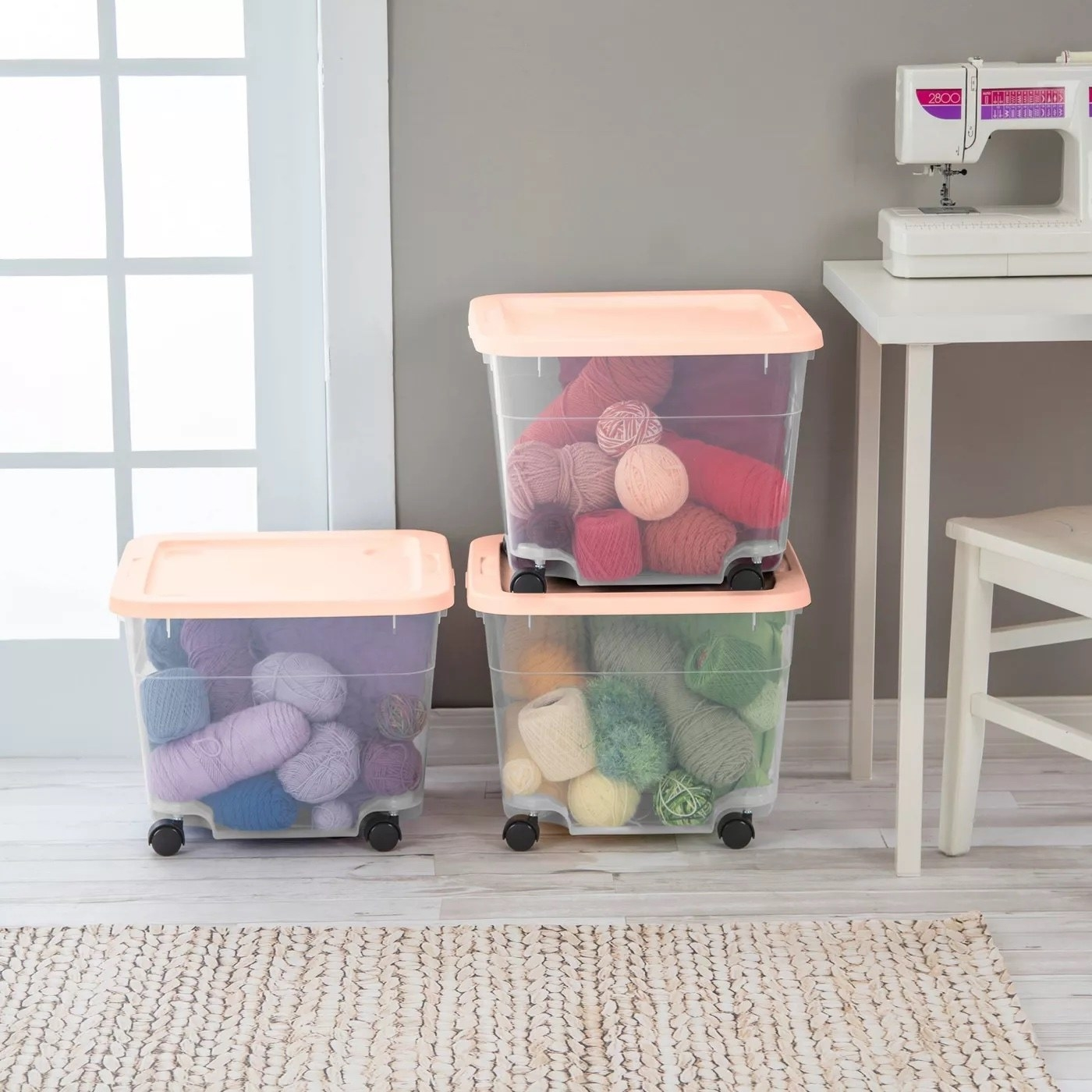 Three storage bins with two in a stack