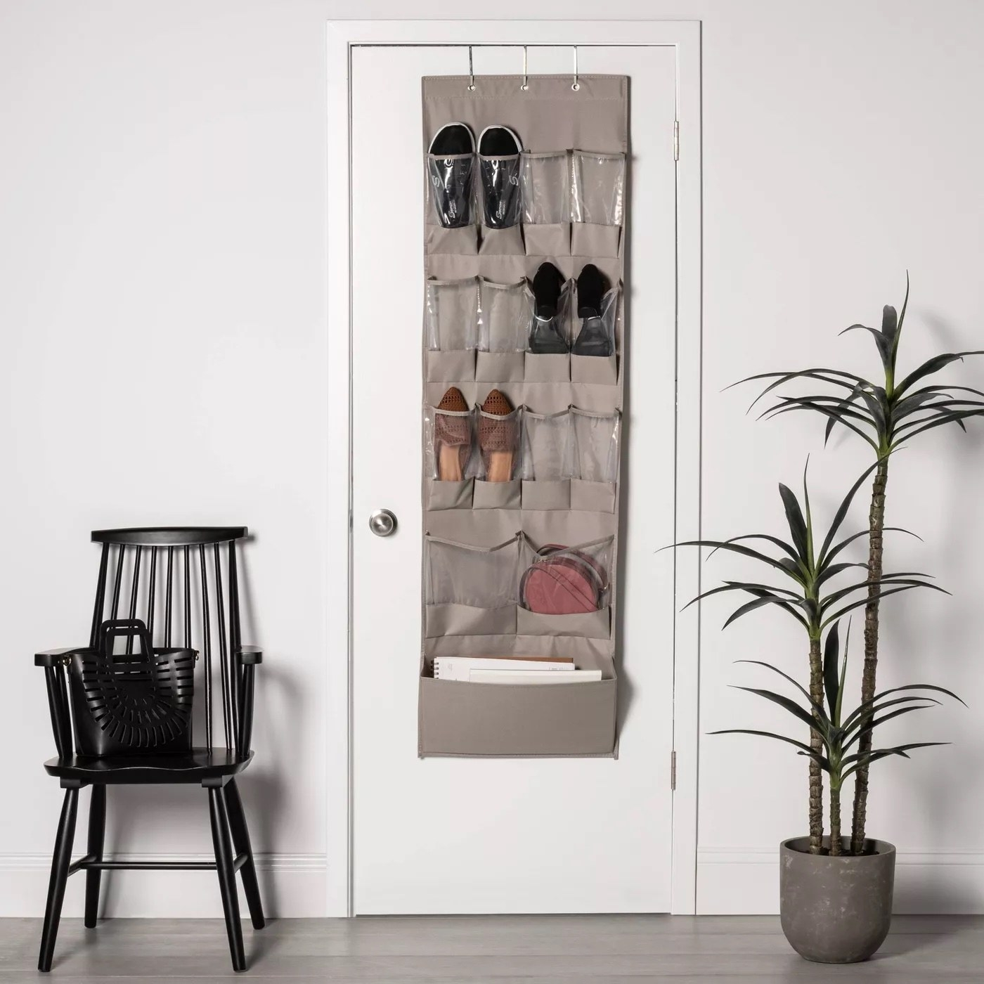 The overdoor organizer with various items inside