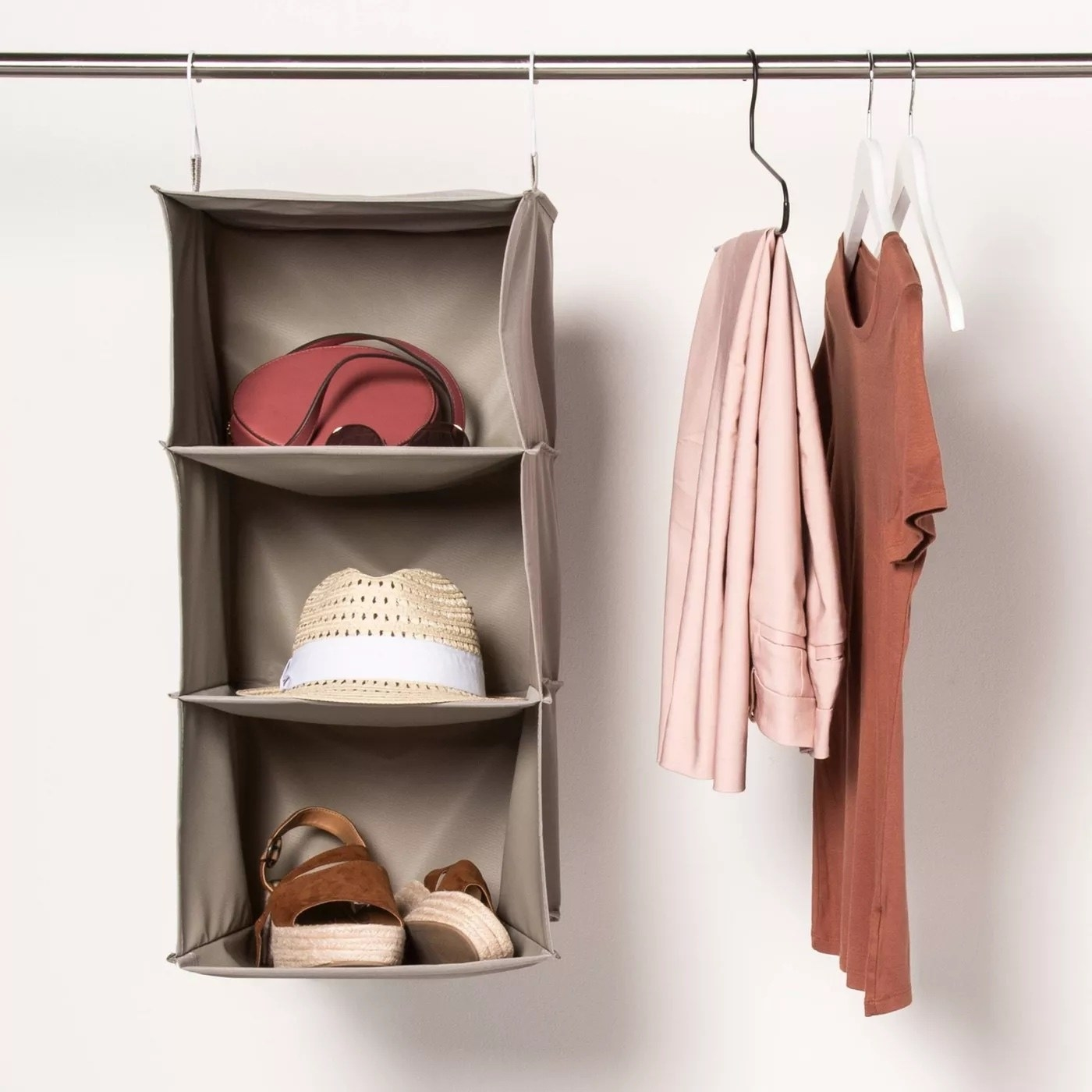 The hanging closet organizer with assorted items inside