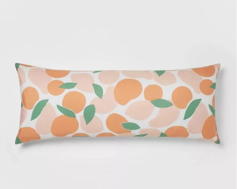 A rectangular pillow with a peach pattern