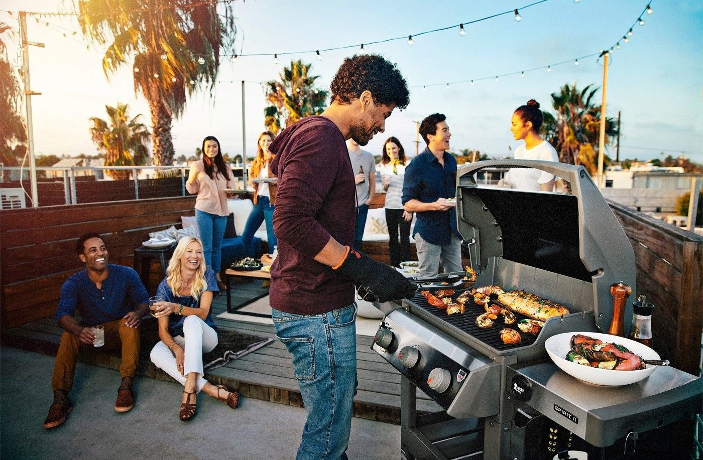 people gathered around a grill