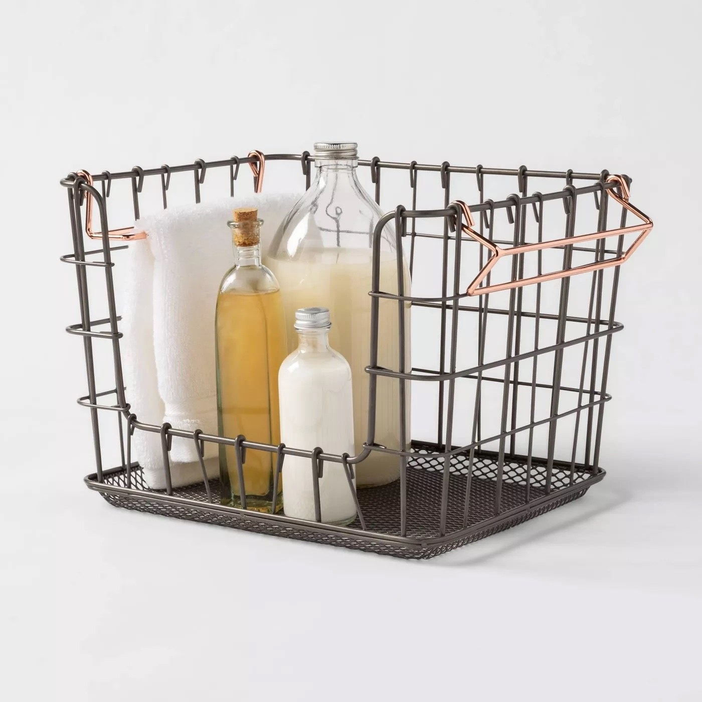 The wire basket with assorted items inside
