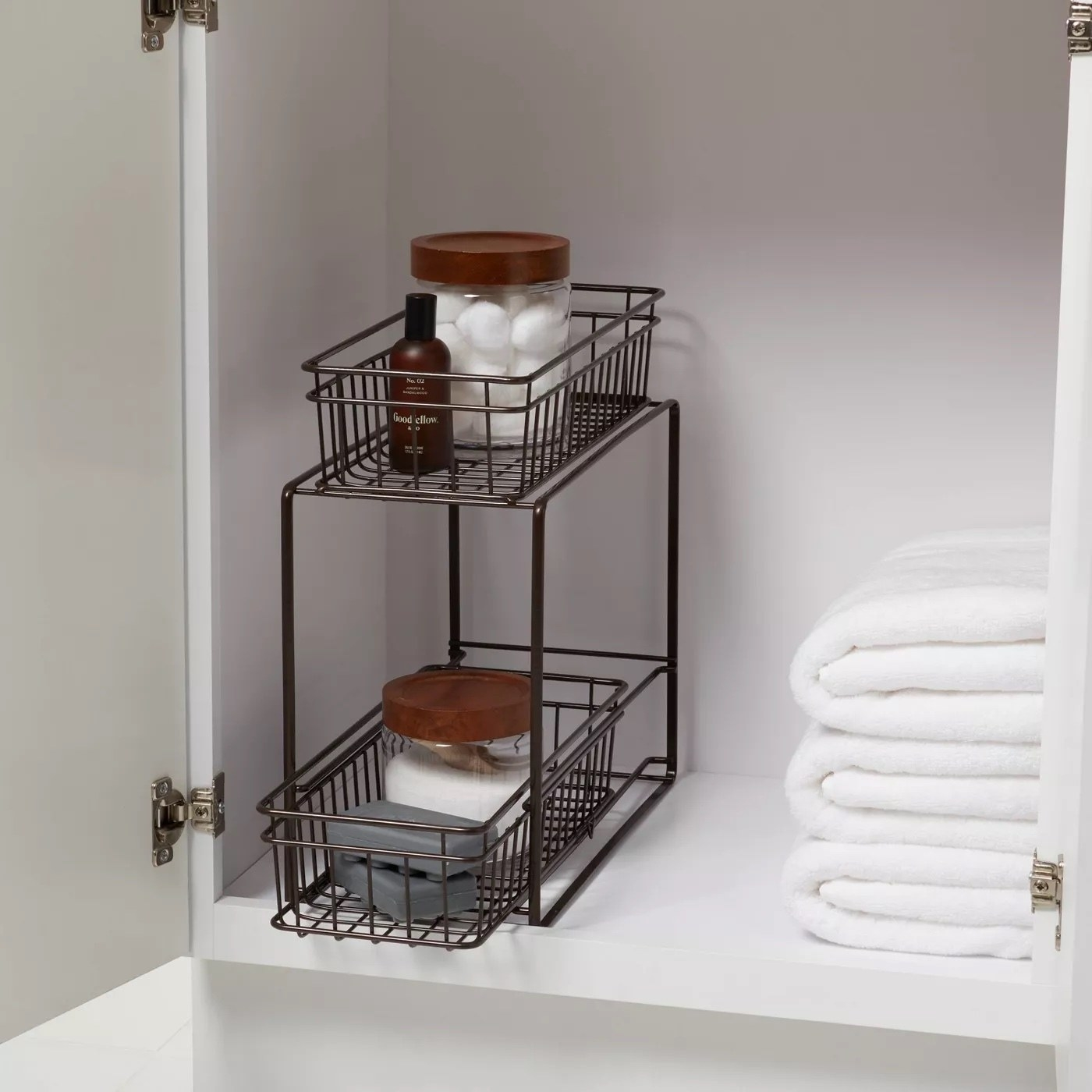 The two tier storage rack with assorted items inside