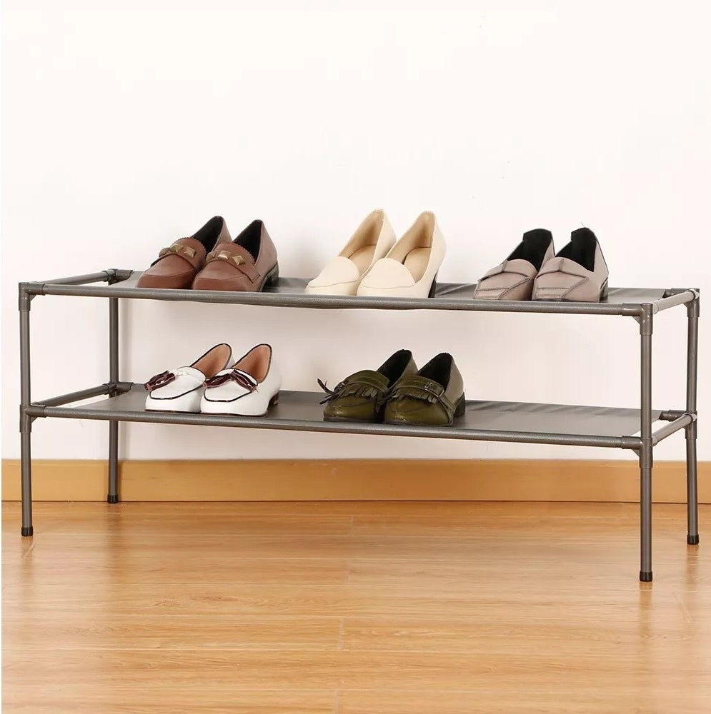 The shoe rack with five pairs of shoes on it