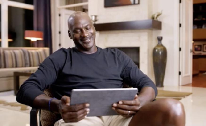 "Jordan looking down at his iPad in the ""Last Dance"" documentary"