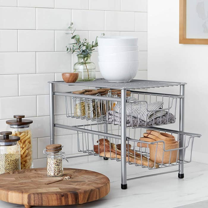 the amazon basics two tier sliding drawer on a marble countertop