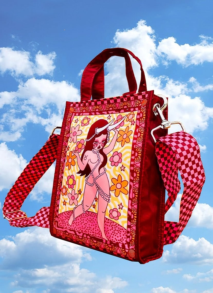 a bag with a taurus-inspired design on it and red and pink checkerboard straps