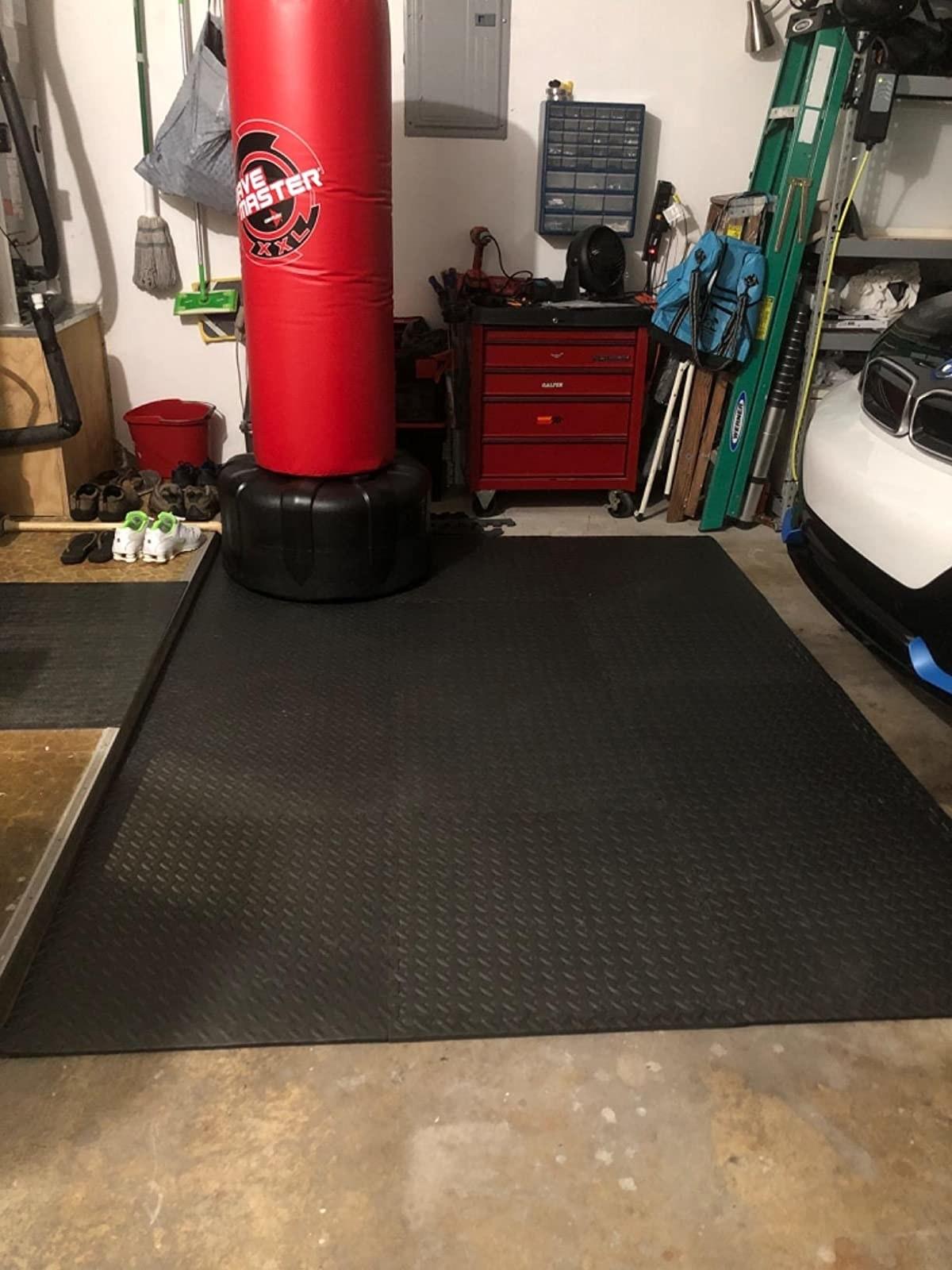 black interlocking exercise mat on garage floor