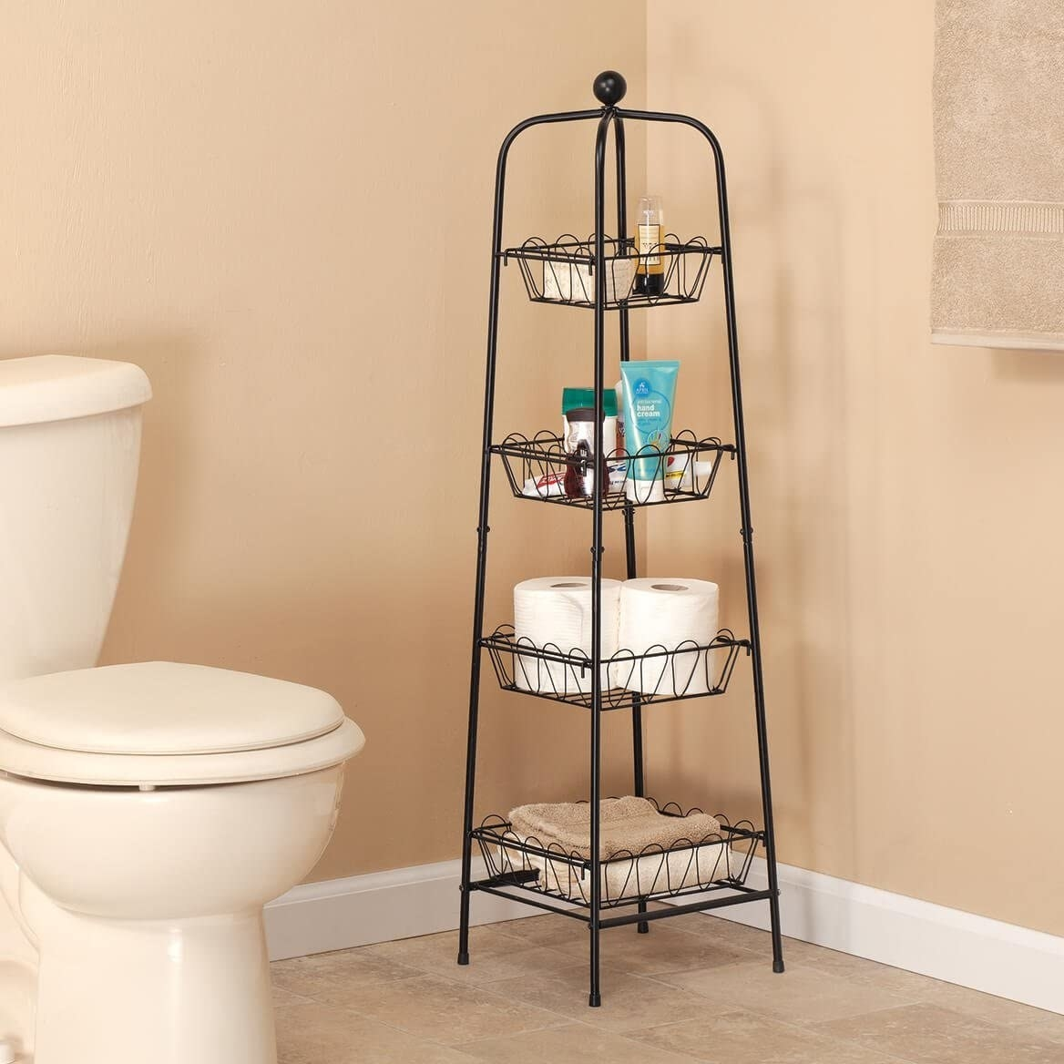 the four tier metal organizer holding toiletries in a bathroom