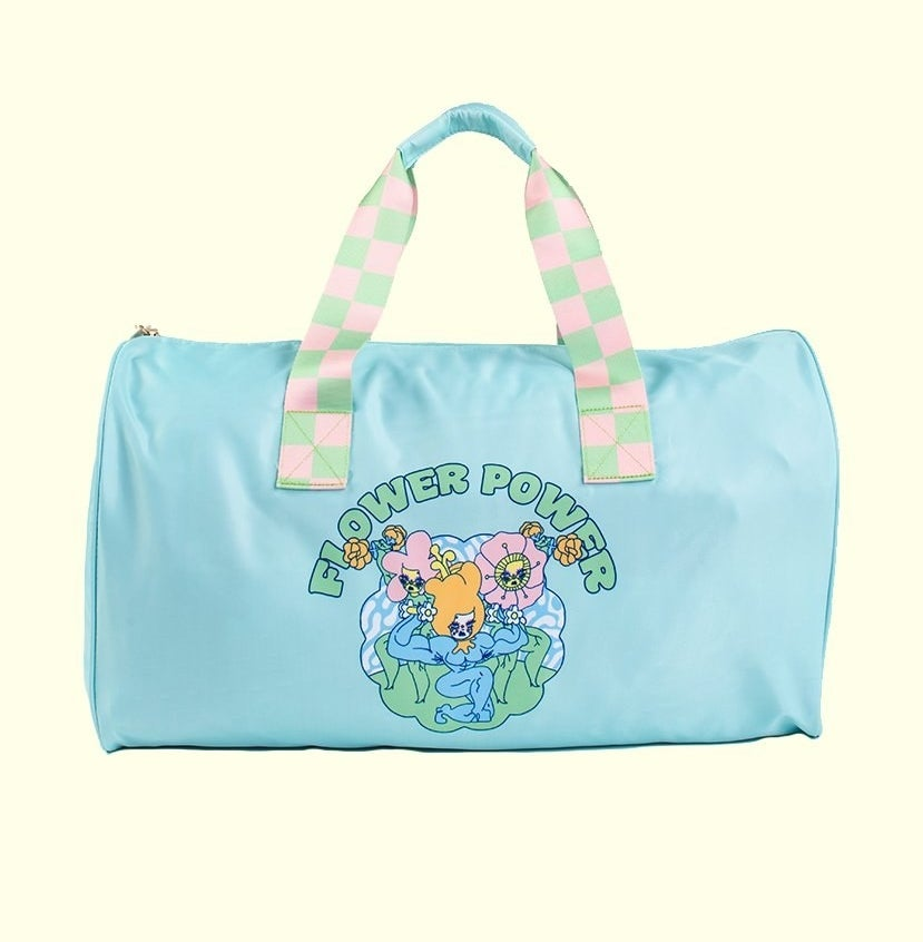 """a light blue bag with three flowers on it and """"flower power"""" written above them"""