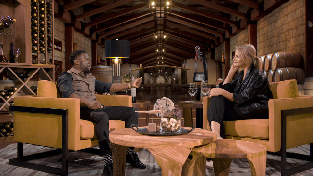 Kevin Hart sits chatting with Cameron Diaz