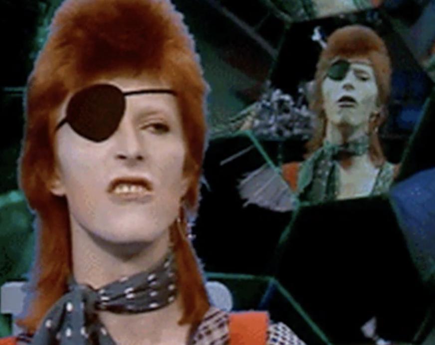 "Bowie in his ""Rebel Rebel"" music video"