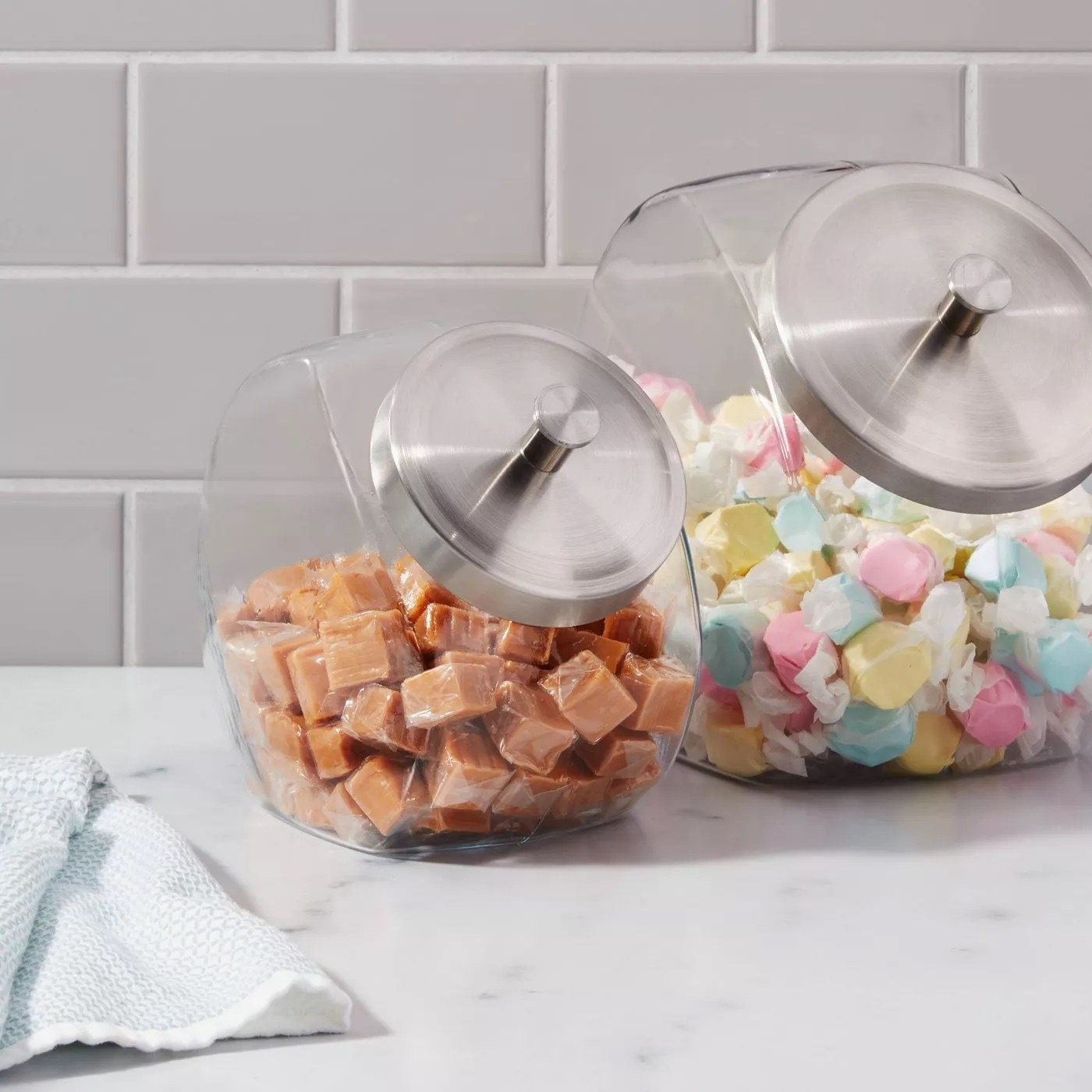 Two penny jars with different types of candy inside
