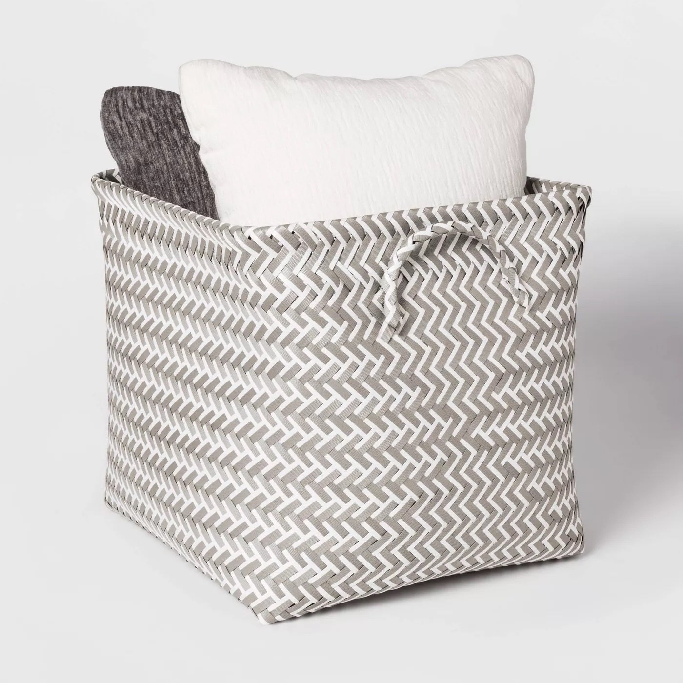 The storage bag with pillows inside