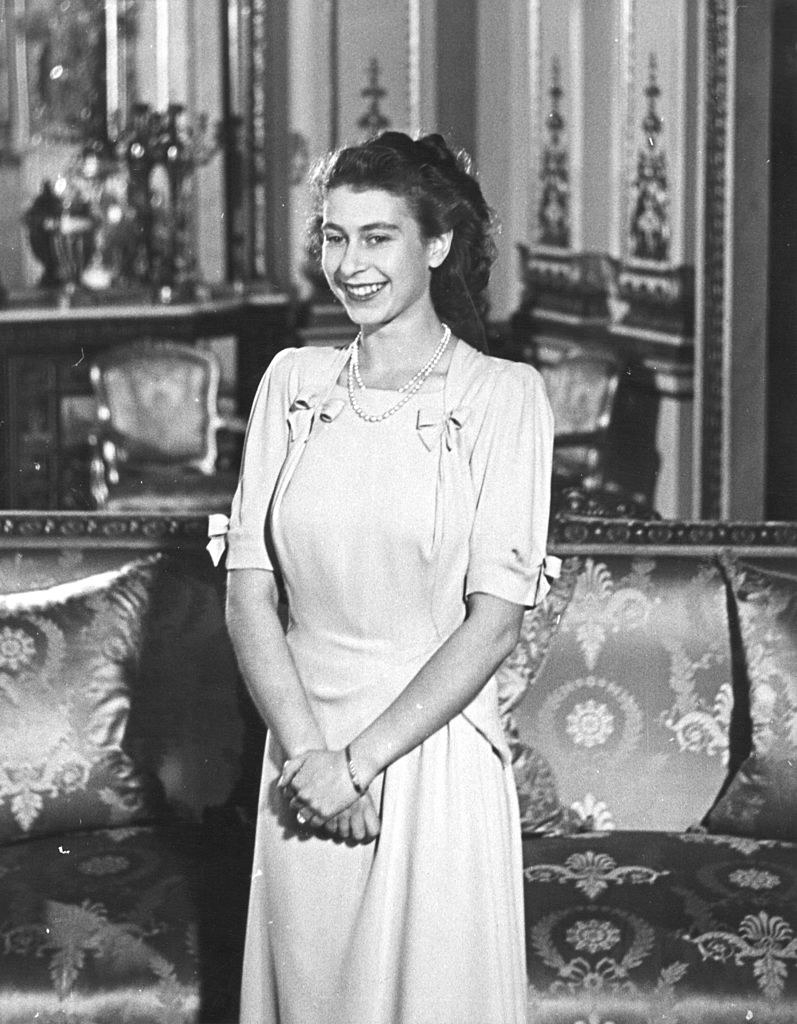 Smiling in 1947 with her hands folded in front of her