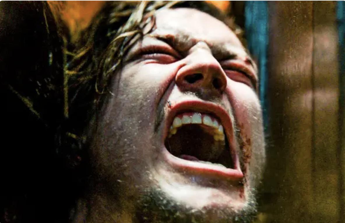 A man screams in agony