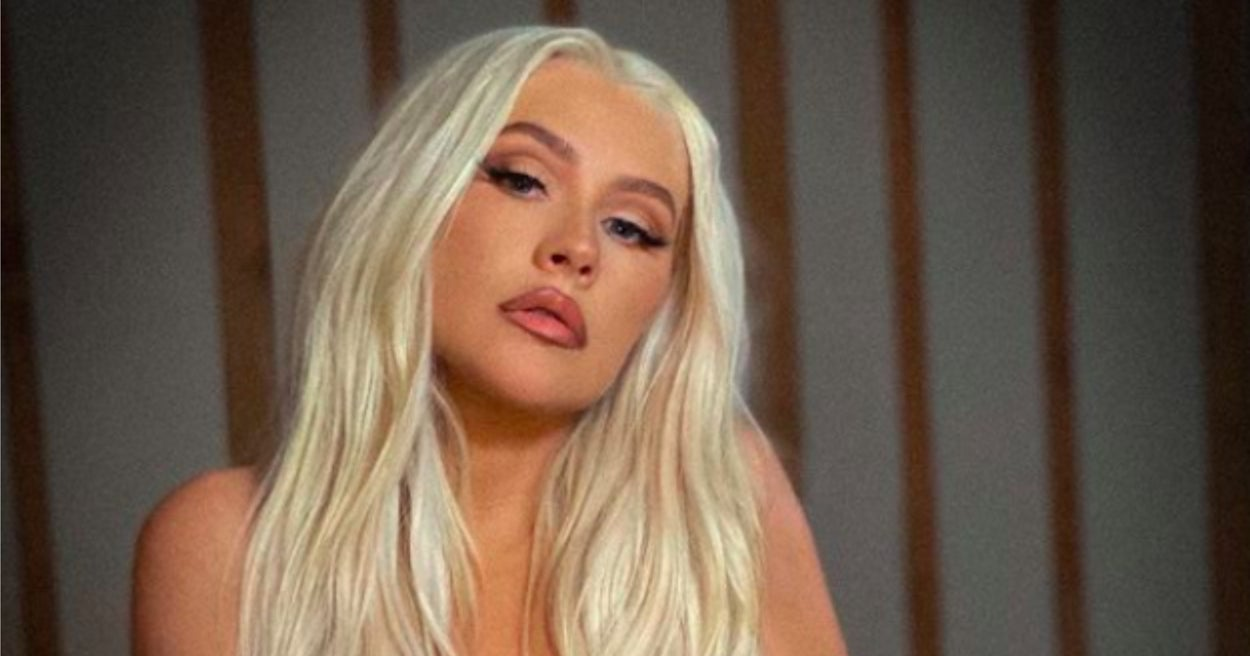 """Christina Aguilera Channeled Her """"Stripped"""" Era As She Posed Topless To Promote Her Upcoming Show"""