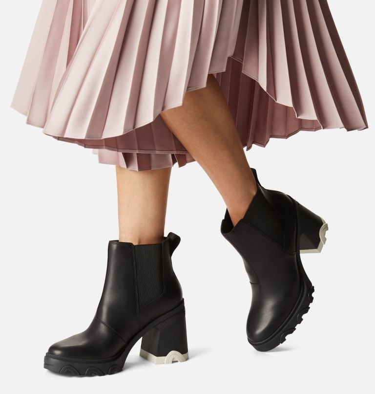 model wearing the chunky heeled black boots