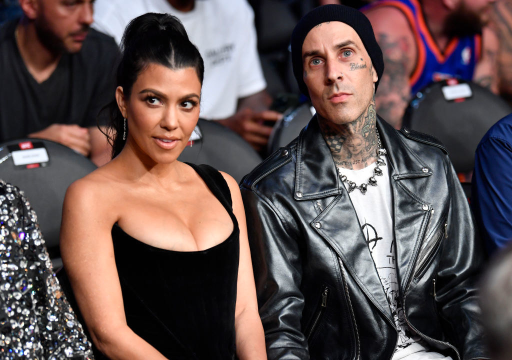 Kourtney and Travis sitting together at an event