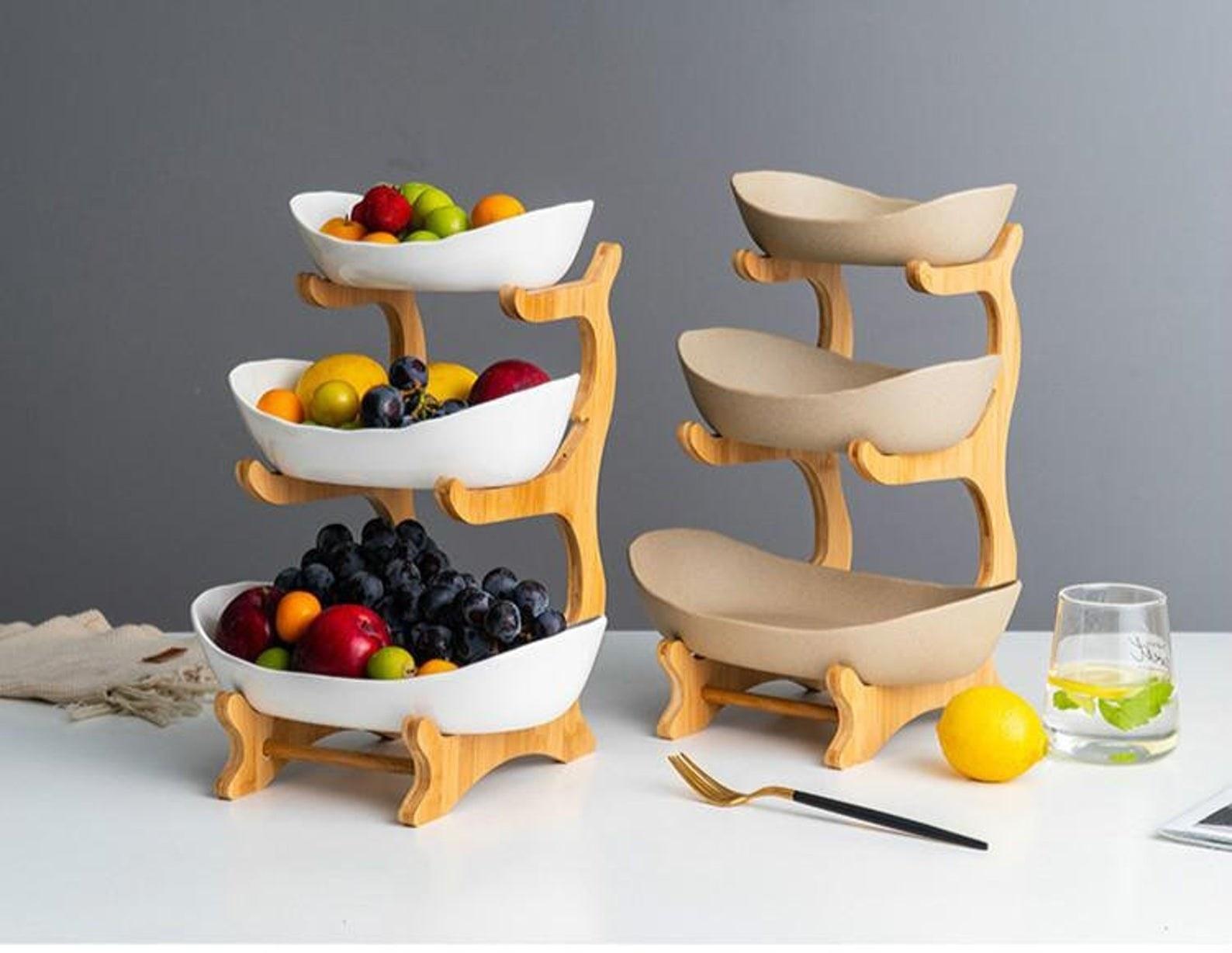 three tier holders of fruit bowls