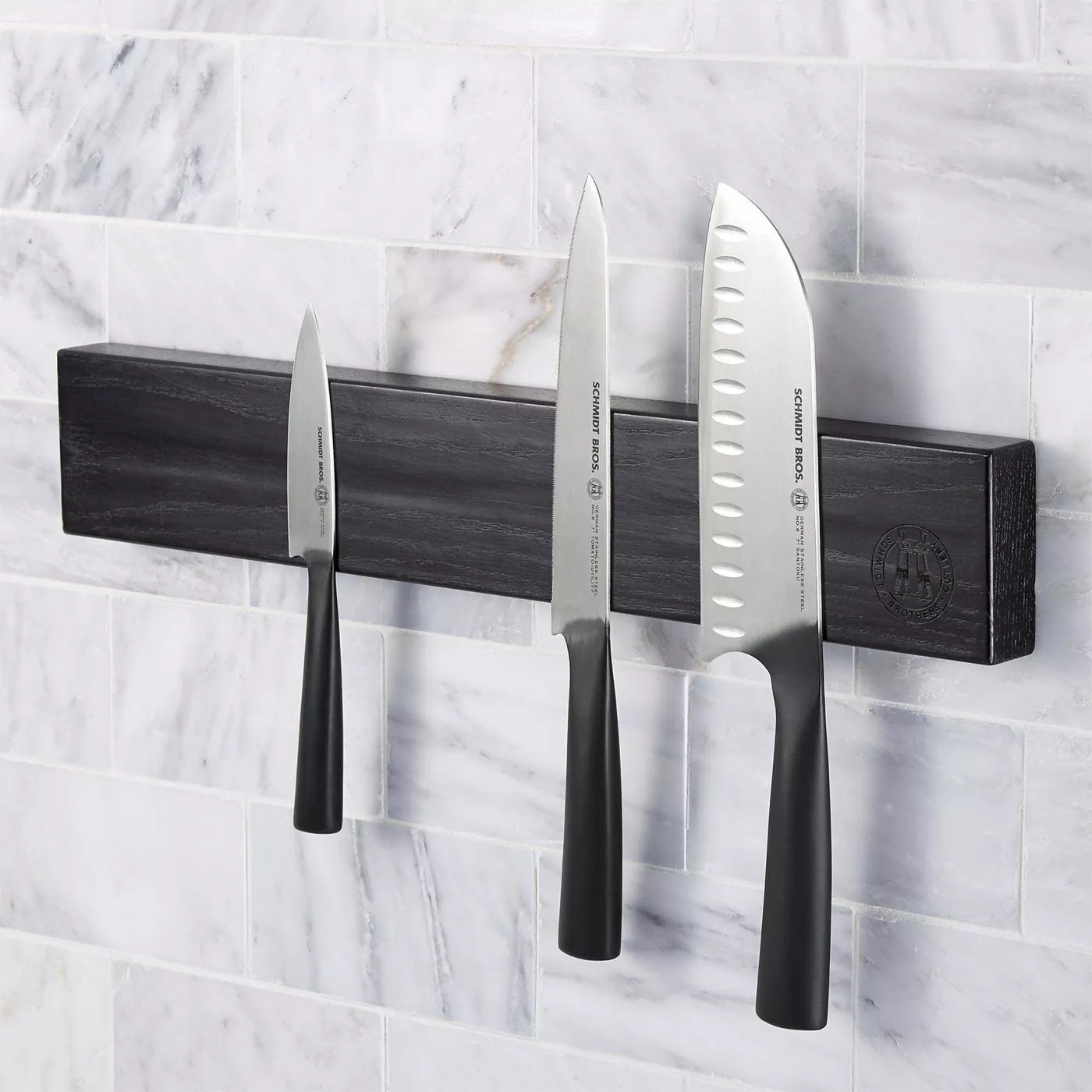 The wall bar with three knives on it
