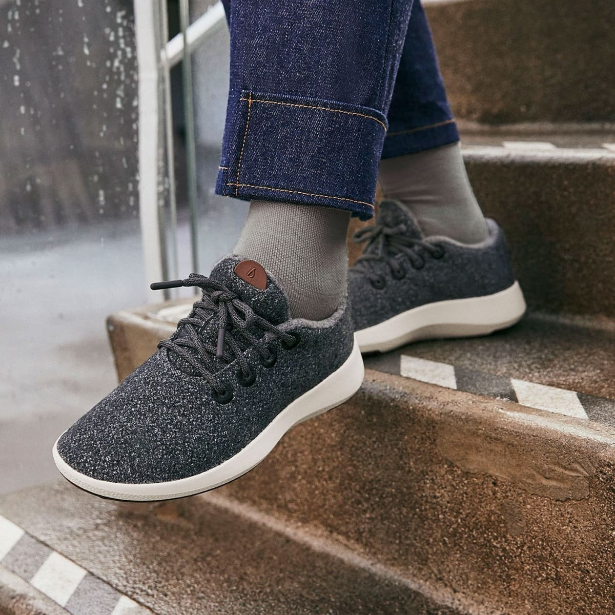 model wearing heathered dark grey lace-up sneakers