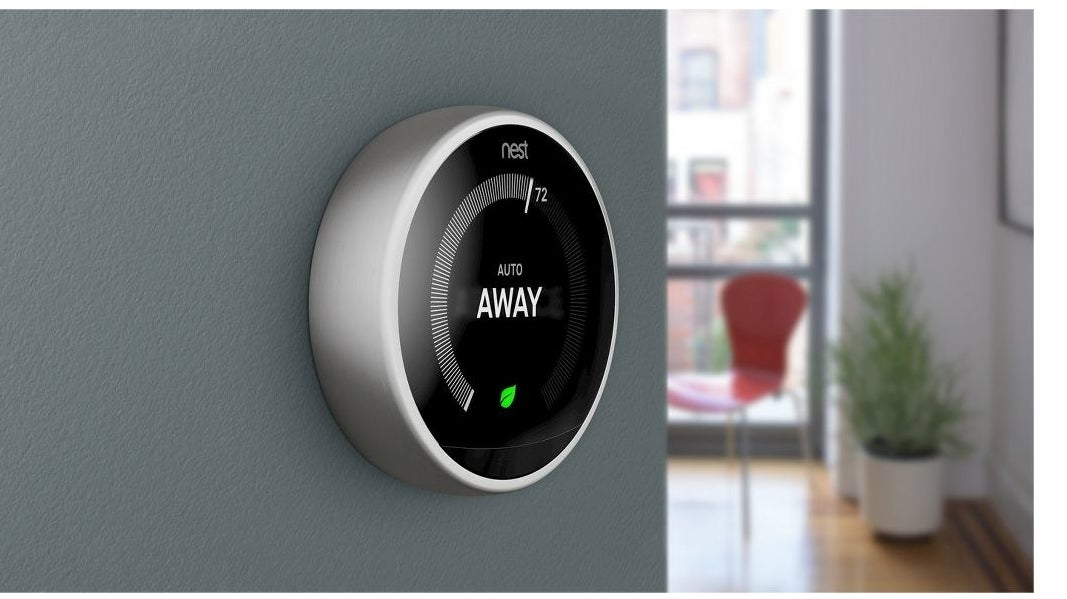 silver circular nest thermostat on a wall
