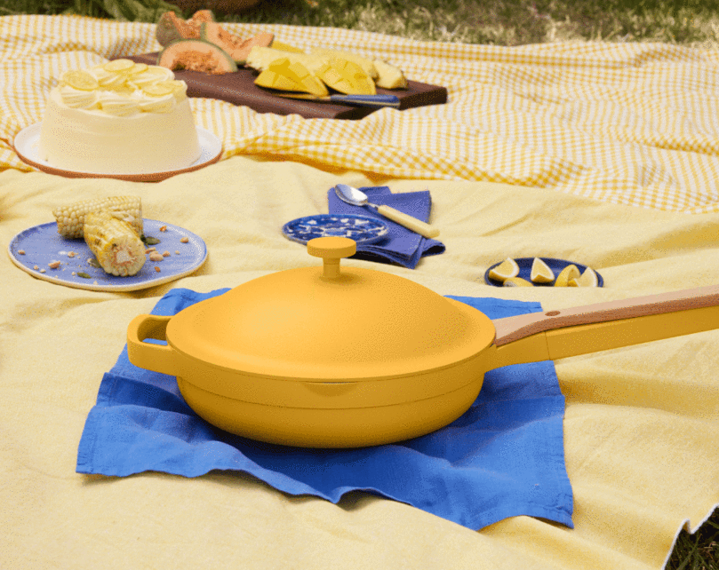 the yellow always pan on a picnic blanket