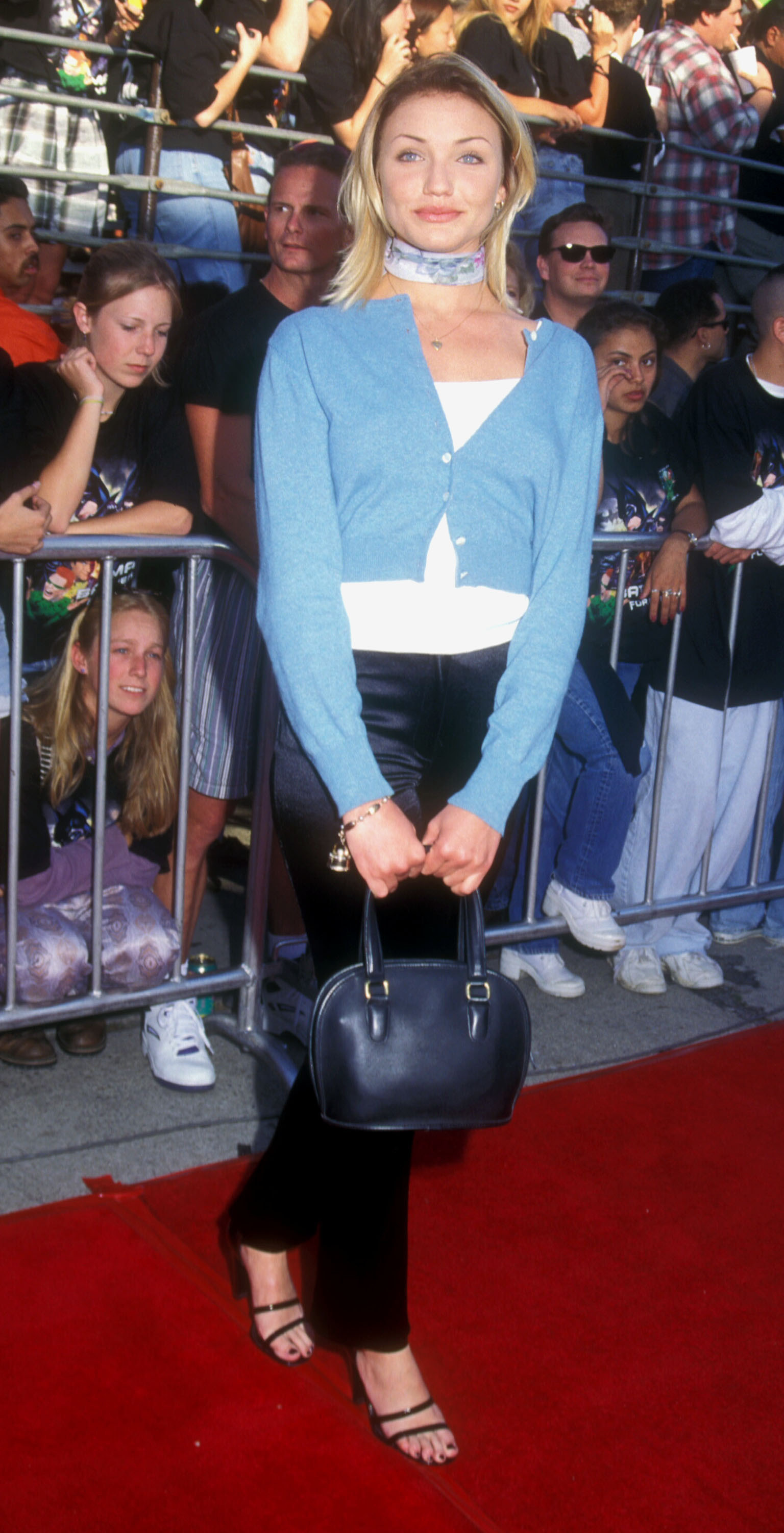 Cameron Diaz in a blue sweater and black pants