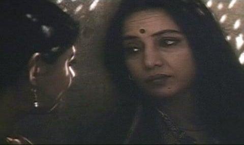 Sita looking at Radha